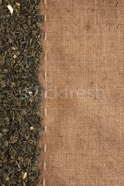 Green tea supplements is on sackcloth Stock photo © alekleks