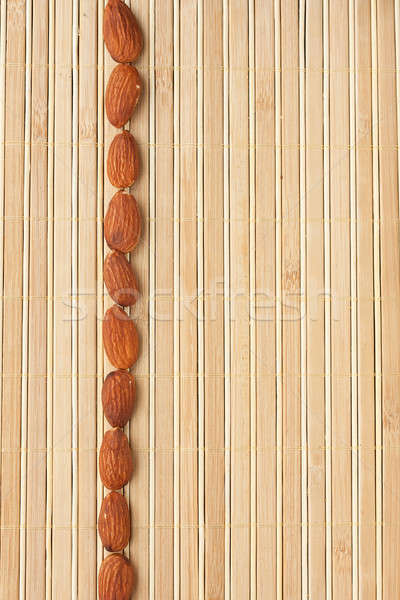 Cases a band of  almond  lying on bamboo mat Stock photo © alekleks