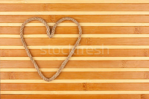 Symbolic heart made of rope lying on a bamboo mat Stock photo © alekleks