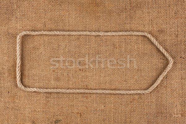 Arrow made of rope lying on burlap Stock photo © alekleks