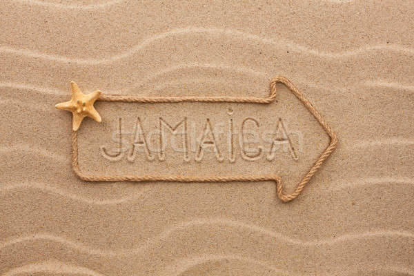 Arrow made of rope and sea shells with the word Jamaica on the s Stock photo © alekleks