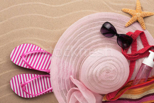 Accessories for the beach lying on the sand Stock photo © alekleks