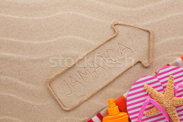 Jamaica  pointer and beach accessories lying on the sand Stock photo © alekleks