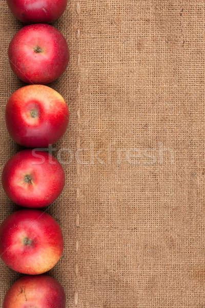 Red apples lie on sackcloth Stock photo © alekleks