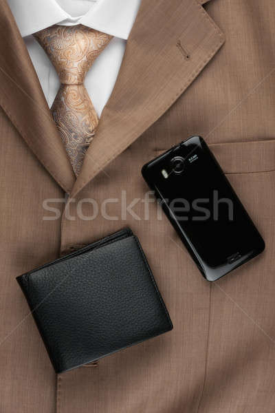 Purse and phone lying on the suit and tie Stock photo © alekleks