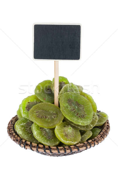 Heap of dried  kiwi  in a plate, with a pointer for your text Stock photo © alekleks
