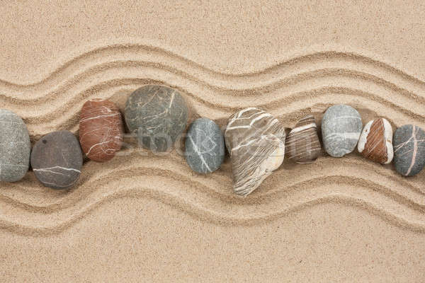 Striped stones on the sand Stock photo © alekleks
