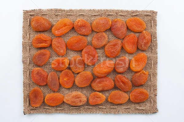Frame made of burlap with dried apricots Stock photo © alekleks