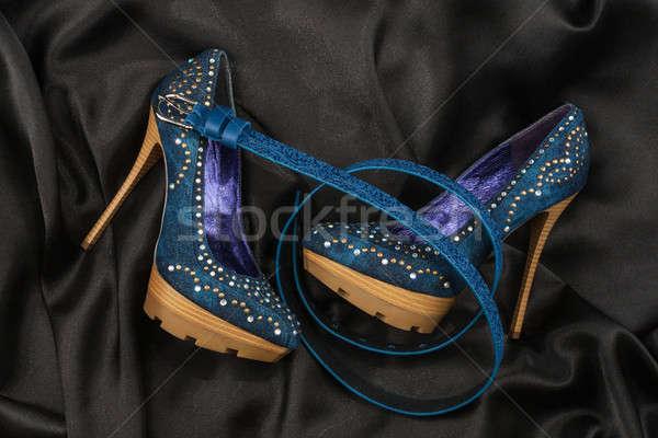 Blue shoes and belt  lying on black satin Stock photo © alekleks