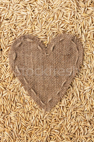 Frame in the shape of heart made of burlap with oats Stock photo © alekleks