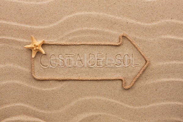 Arrow made of rope and sea shells with the word Costa del Sol on Stock photo © alekleks