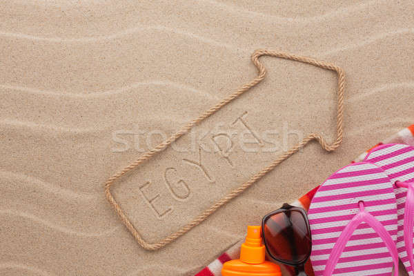 Egypt  pointer and beach accessories lying on the sand Stock photo © alekleks