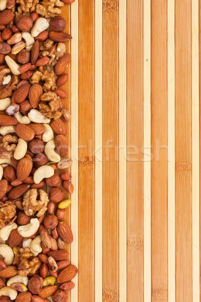 смесь орехи бамбук природы пространстве группа Сток-фото © alekleks