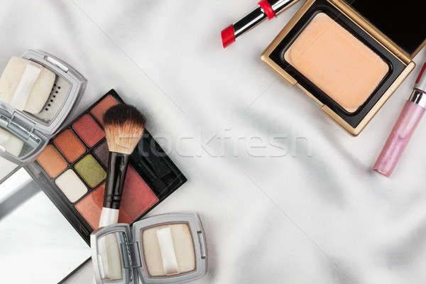 Beautiful picture of cosmetic  on  white  satin Stock photo © alekleks