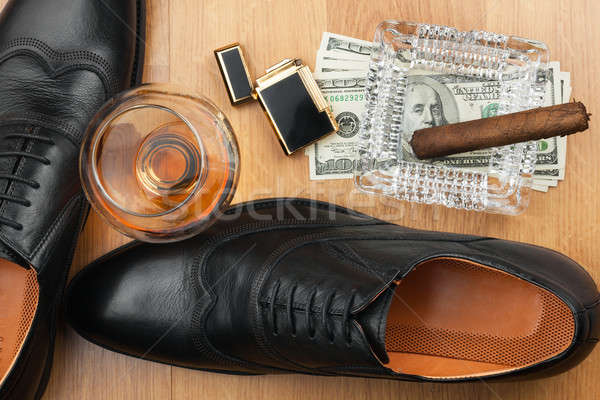 Cigar, ashtray, lighter, money, shoe, glass   on  wooden floor Stock photo © alekleks