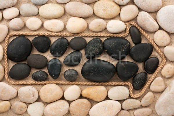 Pointer made of rope with white and black stones Stock photo © alekleks