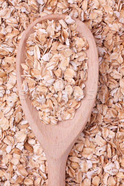 oat-flakes with a wooden spoon Stock photo © alekleks