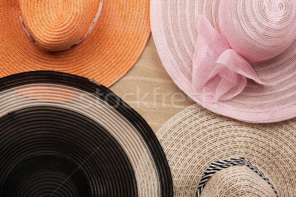 Four  hat lying on the undulating sand Stock photo © alekleks