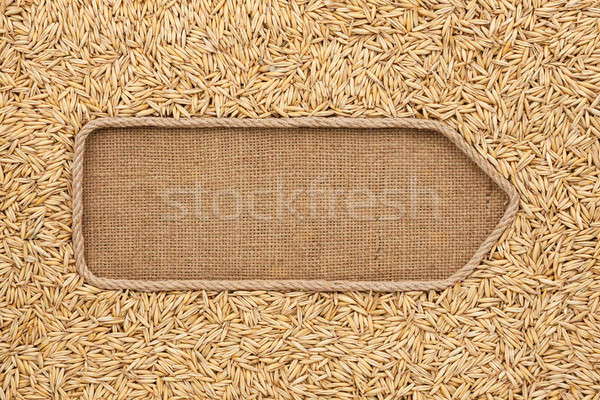 Pointer made from rope with grains oats lying on sackcloth Stock photo © alekleks