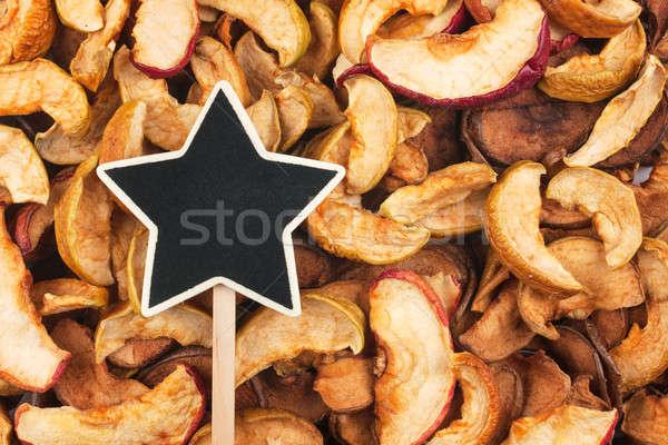 Pointer, the sign  lies on dried apple Stock photo © alekleks