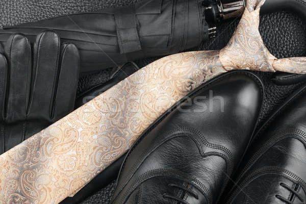 Classic mens shoes, tie, gloves, umbrella on natural skin Stock photo © alekleks