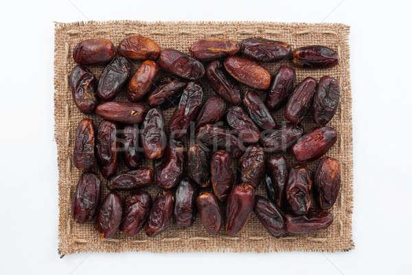 Cadre toile de jute dates blanche alimentaire fond Photo stock © alekleks