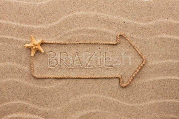 Arrow made of rope and sea shells with the word Brazil on the sa Stock photo © alekleks