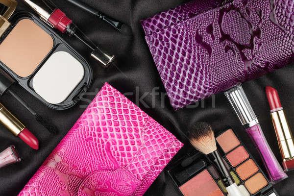 Beautiful pink and lilac bags among cosmetics Stock photo © alekleks