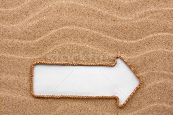 Pointer made of rope with a white background on the sand Stock photo © alekleks