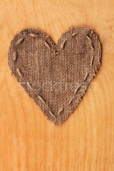 Heart  of  burlap, lies on a background of wood Stock photo © alekleks