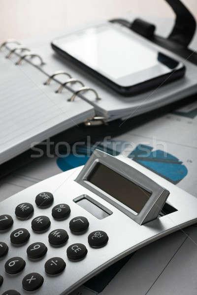 ストックフォト: 表 · ビジネスマン · 事務用品 · 手紙 · 電卓 · 白