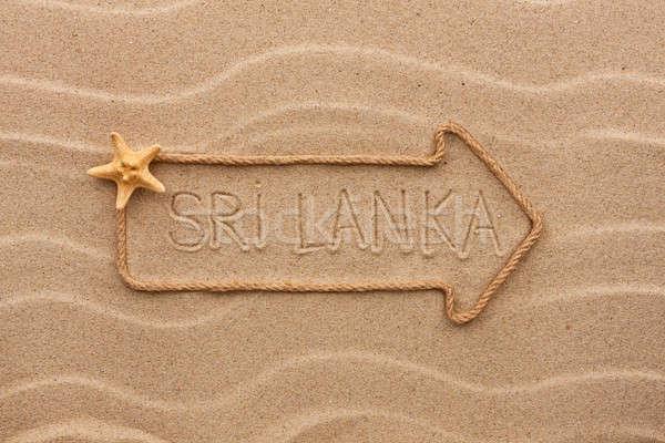 Arrow made of rope and sea shells with the word Sri Lanka on the Stock photo © alekleks