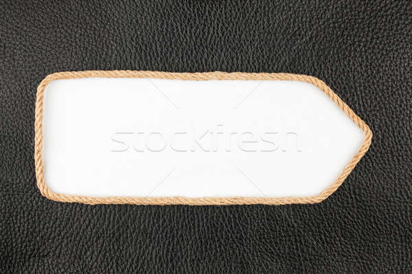 Arrow made of rope  lies on a background of natural  leather Stock photo © alekleks