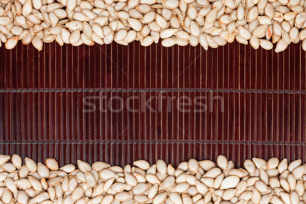 pumpkin seed  on a dark  bamboo mat Stock photo © alekleks
