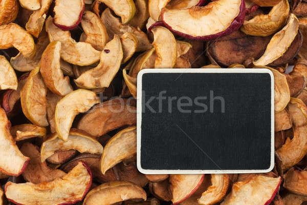 Pointer, the price tag lies on dried  apple Stock photo © alekleks