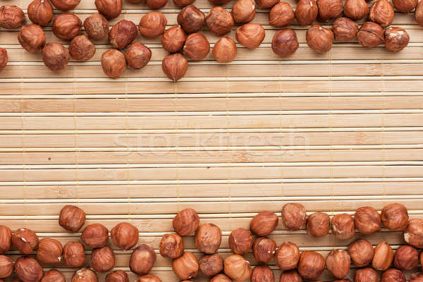 Hazelnut  lies on the a bamboo mat Stock photo © alekleks