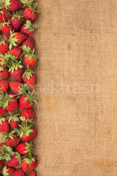 Strawberries lies on sackcloth Stock photo © alekleks
