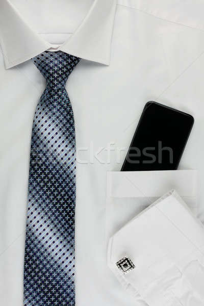 Shirt, tie, cuff links and a mobile phone Stock photo © alekleks