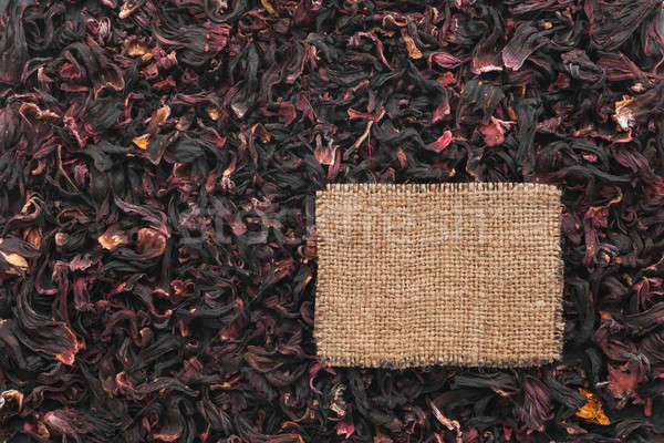 Tag made of burlap lies against the backdrop of hibiscus Stock photo © alekleks