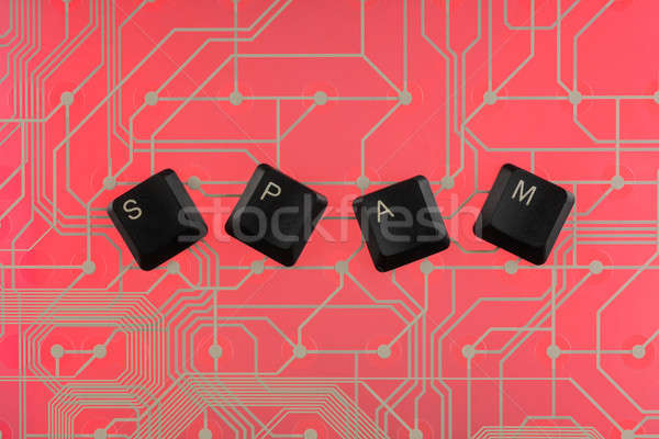 Keyboard keys laid out the word spam Stock photo © alekleks