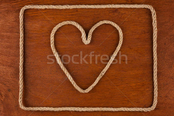 Heart made of rope on a wooden surface Stock photo © alekleks
