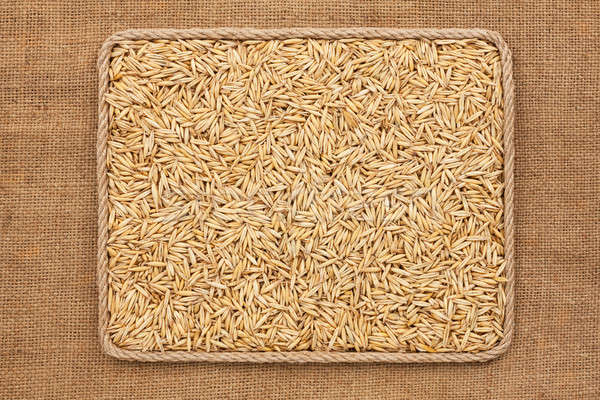 Frame made of rope with  oats  grains on sackcloth Stock photo © alekleks
