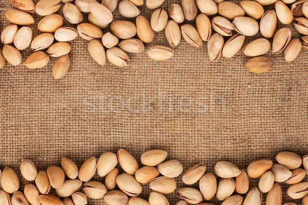 Stitching and sewing pistachios lying on sackcloth  Stock photo © alekleks