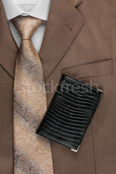 Passport lying on the jacket, tie and shirt Stock photo © alekleks