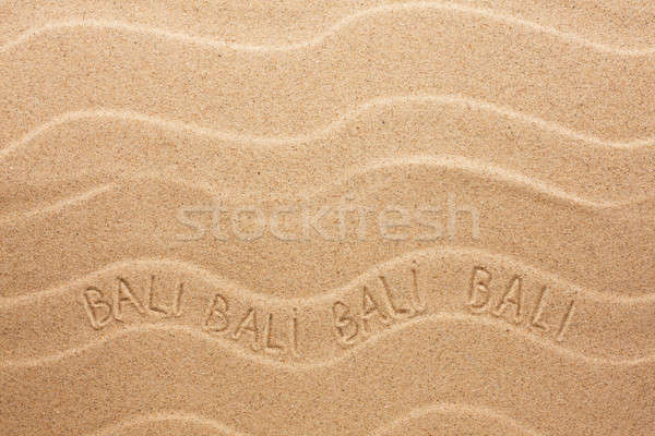 Bali inscription on the wavy sand Stock photo © alekleks