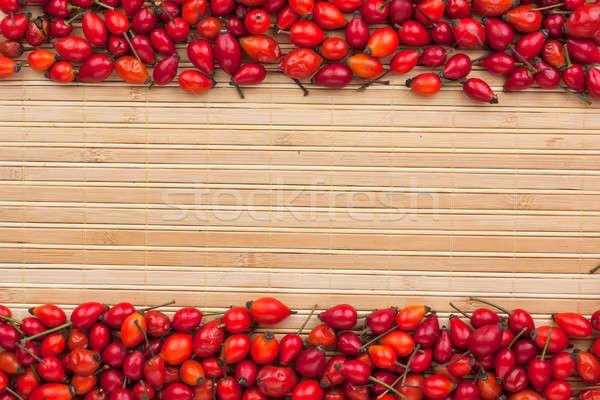rosehip  on  a   bamboo  mat Stock photo © alekleks