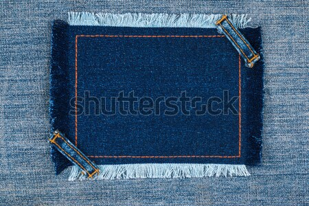 Frame with two straps jeans, lies on the light denim Stock photo © alekleks