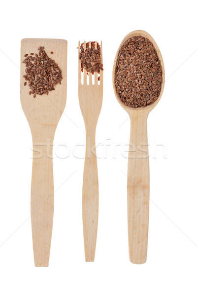 Wooden spoon, fork, paddle with  flax seed Stock photo © alekleks