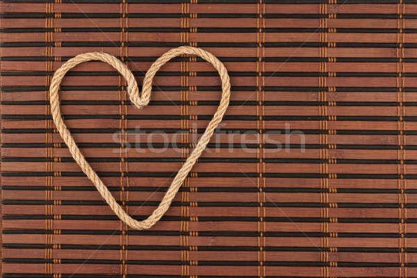 Simbólico coração corda bambu abstrato fundo Foto stock © alekleks