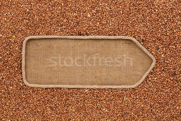 Pointer made from rope with grains buckwheat  lying on sackcloth Stock photo © alekleks